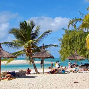 tourists relaxing in diani beach